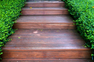 Bigstock-Wood-Stair-Way-On-Green-Garden-35981329-300x199
