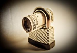 Bigstock-Money-Lockdown-7642848-300x206