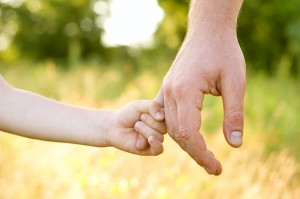 Bigstock-trust-family-hands-of-child-so-27258686-300x199