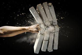 Bigstock-Close-up-of-human-hand-breakin-54368582