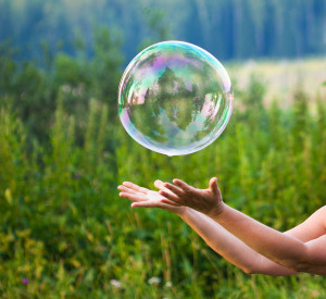 Bigstock-hand-catching-a-soap-bubble-26919833-300x275