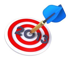 Bigstock-Dart-hitting-target-New-Year-31745273-300x257