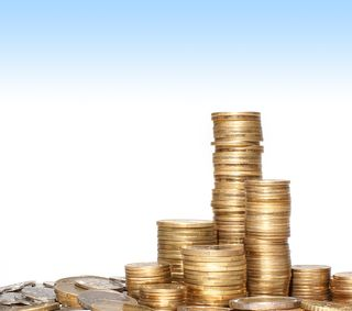 Bigstock-Golden-coins-isolated-on-white-14443940