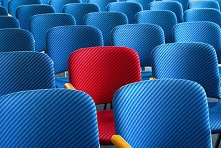 Bigstock-Red-Seat-Standing-Out-62319443