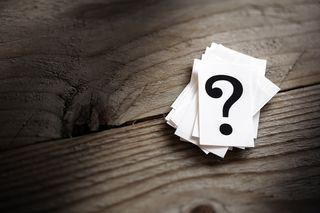 Bigstock-Question-mark-heap-on-table-co-86579810
