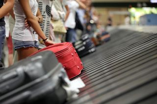 Bigstock-Suitcase-on-luggage-conveyor-b-50936357