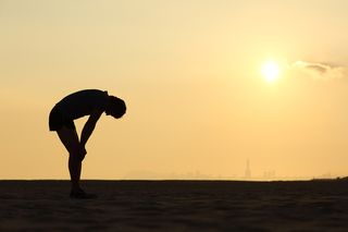 Bigstock-Silhouette-Of-An-Exhausted-Spo-56076581