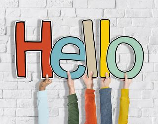 Bigstock-Hands-Holding-Word-Hello-Conce-83016074