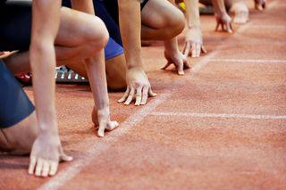 Bigstock-Athletes-At-The-Sprint-Start-L-58880123