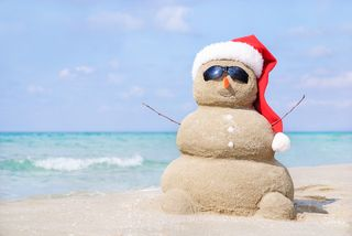 Bigstock-Smiling-Sandy-Snowman-In-Red-S-72707647